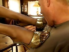 Old man worships ebony hottie's feet sucking succulent toes and licking bare soles