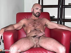 Ryan Cummings is full of cum when muscle man Adam Russo stops by. He feels his sloppy hole and...