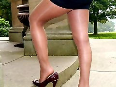 Stunning babe Faye shows off her amazing legs wearing a short skirt, nylons and a pair of tall stiletto heels