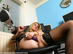 Secretary Ashleigh in stockings and heels with her dildo
