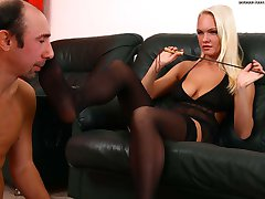 Old bearded slave sniffs his dominas sweaty pantyhose and cleans her feet with his skillful...