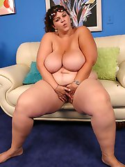 Lusty BBW Mona Mounds seduces a black hunk with her huge jugs and gets her muff cock humped