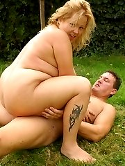 BBW Helga lays on her side allowing her guy to penetrate her fat pussy in a spoon position