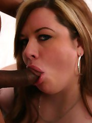 Large and chesty chick Deserie pleasures a black stud with her face hole and fat and wet pussy