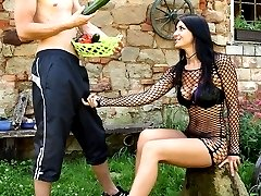 Delicious big titted brunette in fishnets gets her tight ass fucked with a cucumber