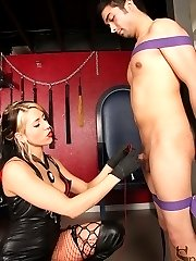 Mistress Dahlia gets sadistically creative with her slave. She straps him to a post and starts...