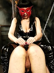Masked latex domme plays with her favorite slaves plugging and dildo-fucking their ass holes