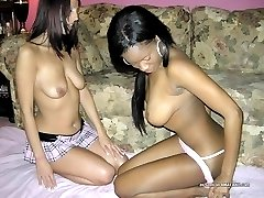 Ebony babe in lesbian action with white chick