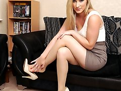 Hot blonde Toni shows her sexy long legs wearing a pair of silky nylons and gorgeous cream...