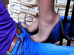 Shoe dangling hottie gets her nylon clad feet creamed after kinky foot sex