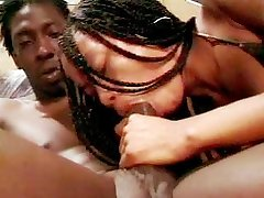 Sex starving ebony chick with braided hair fucks on top of her man.