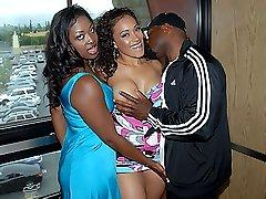 Two sexy black babes tag teams a big black cock
