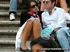 Lovely tourist chick inhot white skirt flashes panties in a Russian park