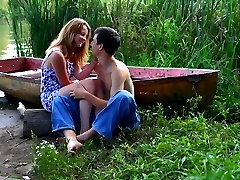 On the secluded shore of this lake, this teen and her lover race to rip off each others clothes....