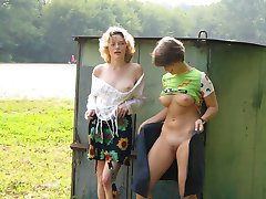 Two lesb girls flash and toy in public