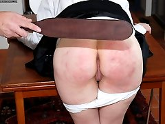 Two young schoolgirls bent over for the leather tawse