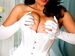 Danica Collins in white lace corset, stockings and satin gloves