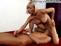 Busty blonde mistress gives her slave a crazy hardcore handjob while facesitting him with no mercy