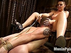Mistress Penny Flame puts hungry masochist Wolf Hudson in his place right away: on his knees with his face buried in her pussy.