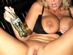 Sexy slut fucks herself with different bottles in a classic convertible