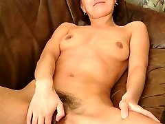Matured sandy-haired girl still proves her libido in a bushy banghole display.
