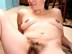 Babe spreads open her bushy beaver to accept some hard cock!