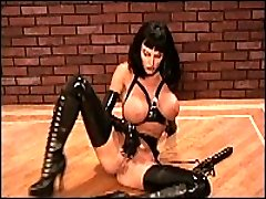 Hardcore lady poses in black latex uniform