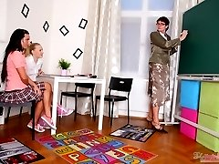 Olya and her sexy young classmate come into their teachers classroom after class to receive the discipline, after they've caused mischief and might cause more.