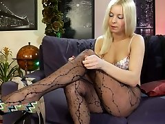 Long-legged beauty trying on luxury hose with mock stocking and lace-up effect