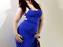 Gorgeous curvy redhead Jay shows off her sexy nylon hold-ups and a lovely blue party dress