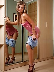 Cutie wears fine barely visible pantyhose under her too short denim miniskirt
