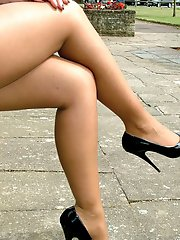 Stunning blonde shows off her long legs and cheeky high heels outside
