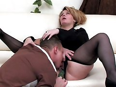 Mature business woman in full-fashioned pantyhose taking cock up her beaver