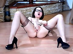 Nerdy girl in glasses gets to upskirt tease and solo sex in suntan nylons
