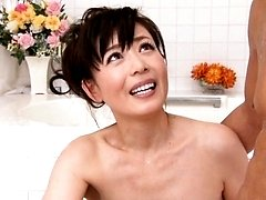 Eriko Miura Asian massages man with oil and JapaneseMatures.com