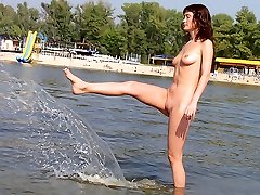 Pin up teen shows off her body at the nude beach