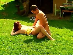 Out in the backyard, this redhead nymphomaniac lets her lover explore all of her body. He uses his hands, his hatch and of course his rock rock-hard trunk to explore her mild body.