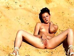 Nude Amateurs at beach posing