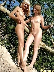 Two beautiful amateur blondies posing in the nude near a birch