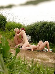 Hot gangbang action near the water is caught on tape
