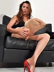 Nylon Jane dressed in lingerie and silky nylons strings up her high heel boots and smokes in her fetish