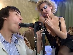 Bitchy damsel makes her man gobble on a faux-cock before pinning his boy-pussy
