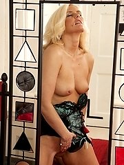 Older blond babe Olivia Jayne masturbates in front of mirror.