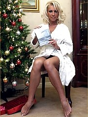 Leggy Lana opens up one of her Christmas presents from a fan, and she is overjoyed at receiving a pair of sexy nylons, so now sit back and watch Lana give you your present