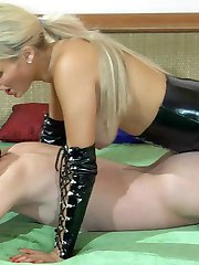 Kinky blonde mistress in leather gear plugs her sub�s mouth and bung hole