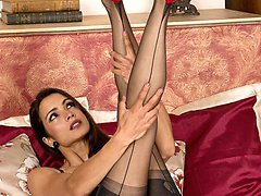 Chelsea peels off her clingy pencil dress revealing a saucy quarter cup bra and sheer black vintage FF nylons!