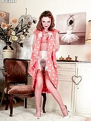 Lola's spread legs sheathed in rare vintage nylons allow a glistening view of her rampant wetness..