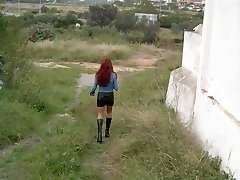 Redhead slut spreading her pussy lips outdoors!