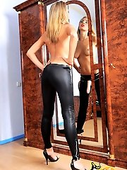 Super hot blonde in bright red lipstick jerks her strap-on and cums all over her heels