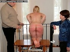 Hot blonde stripped naked and caned hard on her round cheeks